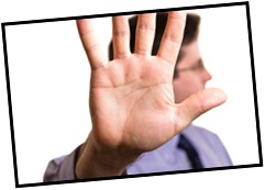 Businessman holding up hand