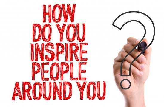 Hand writing the word How Do You Inspire People Around You?