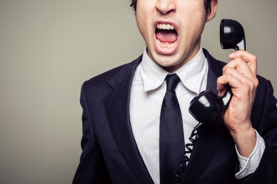 Angry businessman on the phone