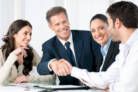 Steps-to-Hiring-a-New-Employeeteam-smiling-with-handshake