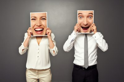 bigstock-man-and-woman-holding-frames-w-45029542